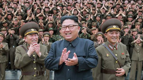 Kim Jong-un surrounded by loyal soldiers. (AAP)