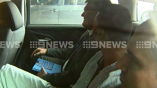 The alleged Bourke Street Mall driver has been taken to police headquarters. (9NEWS)