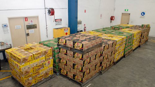 A supplied image obtained on October 6, 2017 of 3.9 tonnes of ephedrine concealed green tea bottles. (AAP)
