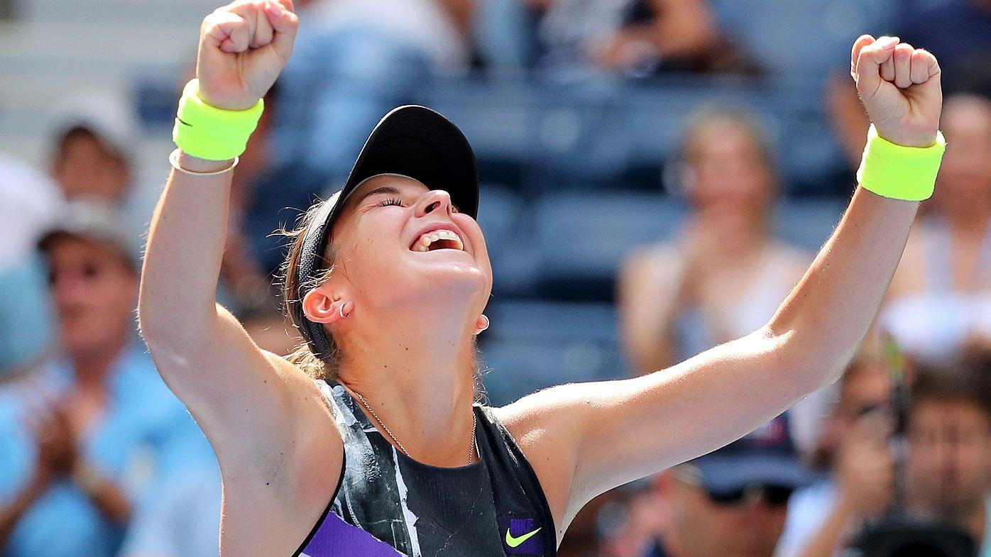 Belinda Bencic of Switzerland celebrates after winning her Women's Singles quarterfinal match against Donna Vekic