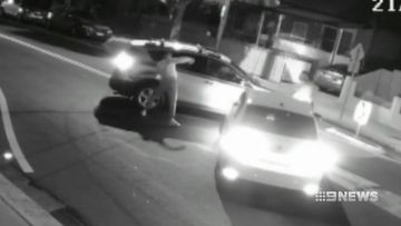 The men get out and one is shown trying to get into the other car, banging on a passenger window.