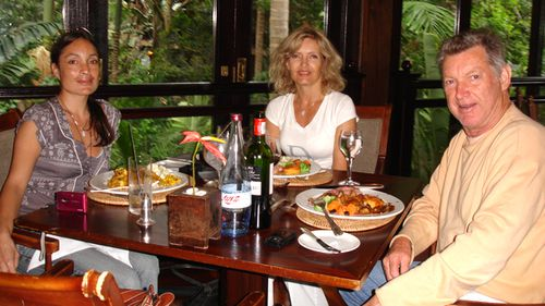 Laura sits with her mother Leona and Leona's late husband Rob in 2008. (Supplied)