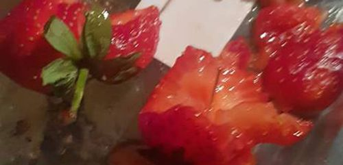 A NSW mum has posted pictures of needles she said she found in strawberries she was eating with her children.