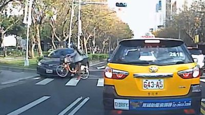 <p>Dashcam footage of a cyclist left on her feet after a car smashed into the front wheel of her bike has been posted online. </p><p> The video, which has not been verified, is either something close to a miracle captured on film, or a pretty decent piece of digital trickery. </p><p> Purportedly from Taiwan, the footage shows a woman cycling across a pedestrian crossing in heavy traffic. </p><p> While most of the traffic is stopped, one sedan comes speeding down the outside lane – ignoring the zebra crossing – and collects the front wheel of the woman's bike, which flies out from under her and smashes into a taxi in the opposite lane. </p><p> The car mounts the curb and grinds to a halt, but here's the kicker: the commuter is left on her feet. </p><p> Totally unhurt, she collects her bag, bike and presumably a bundle of shattered nerves. </p><p> Eventually the taxi driver gets out to have a look at the front of his car, totally ignoring the woman.</p><p> For more close calls, click though our gallery.</p>