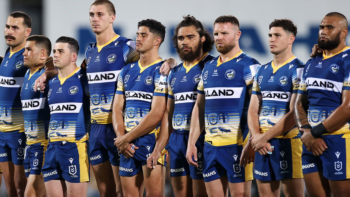 APRIL 23: Eels players pause during an ANZAC ceremony before the round seven NRL match between the Parramatta Eels and the Brisbane Broncos at TIO Stadium, on April 23, 2021, in Darwin, Australia. (Photo by Mark Kolbe/Getty Images)