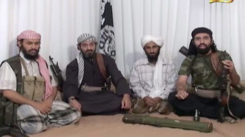 Al-Wuhayshi (second from right) appeared in numerous propaganda videos calling for attacks against the West. (AAP)