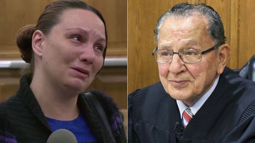 Judge Frank Caprio and the woman he helped by getting rid of her parking fines. (AP)