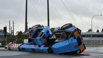 A crane has collapsed across a road in Newcastle, NSW