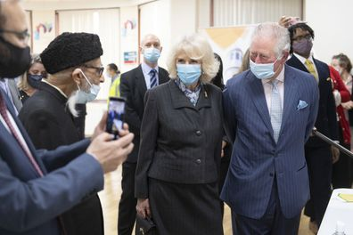Prince Charles, Prince of Wales and Camilla, Duchess of Cornwall wear face masks as they visit a vaccination pop-up centre at Finsbury Park Mosque on March 16, 2021 in London, England.