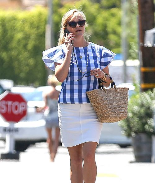 Celebrities like Reece Witherspoon are turning reusable straw bags into a fashion item. Picture: AAP
