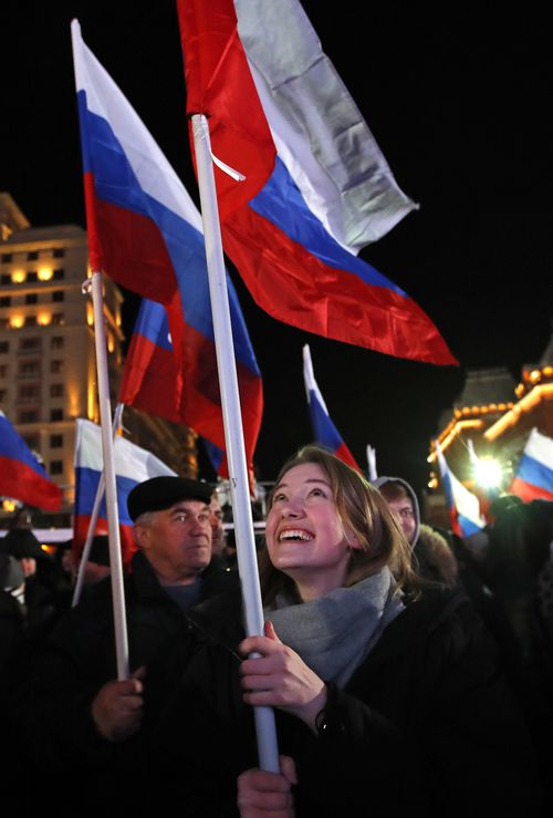 Russians have taken to the streets to celebrate Mr Putin's re-election. (AAP)