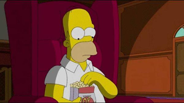 Homer Simpson eating popcorn meme