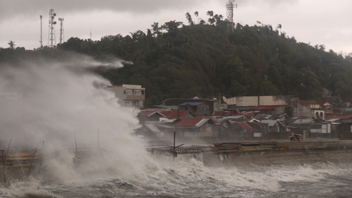 A strong typhoon slammed into the eastern Philippines on Thursday after authorities evacuated tens of thousands of people while trying to avoid the virus risks of overcrowding emergency shelters. (AP Photo/Simvale Sayat)