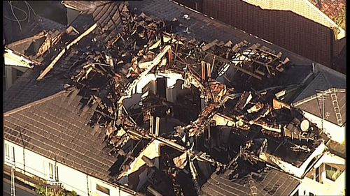 Fire destroys the roof of the two-storey home (9NEWS)