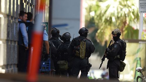 Heavily armed riot police at the scene. (supplied)