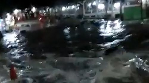 The tsunami left streets flooded.