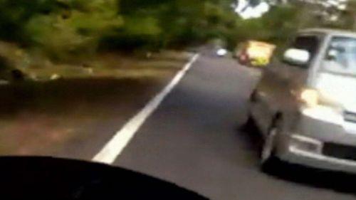 Dashcam footage shows O'Brien swerving around a truck.