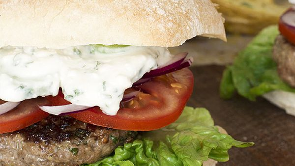 Greek lamb burgers with creamy feta and cucumber sauce and lemony wedges
