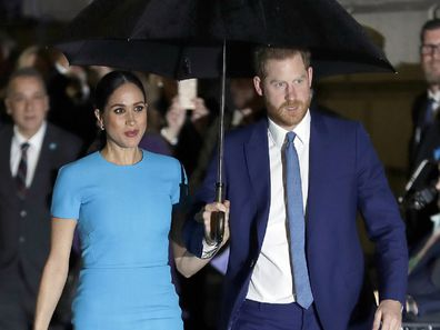 Harry and Meghan arrive at the annual Endeavour Fund Awards in London in the rain.