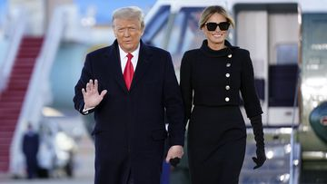 President Donald Trump and first lady Melania Trump arrive on Marine One before boarding Air Force One at Andrews Air Force Base, Md., Wednesday, Jan. 20, 2021
