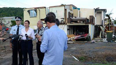 Queensland Premier Annastacia Palaszczu with Deputy Commissioner Steve Gollschewski (left) and Mayor of Livingstone Bill Ludwig outside a damaged house in Yeppoon.