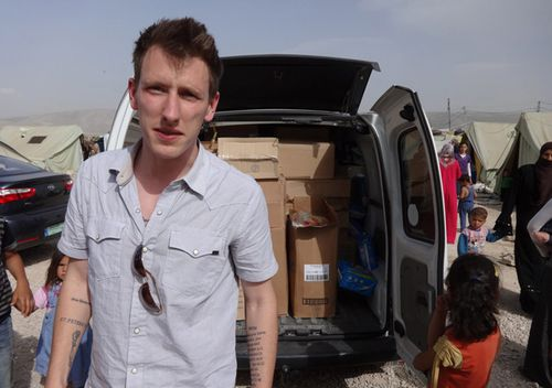 Undated photo shows Peter Kassig standing in front of a truck filled with supplies for Syrian refugees.