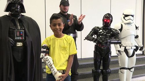 Darth Vader and Stormtroopers surprise young boy with new prosthetic arm