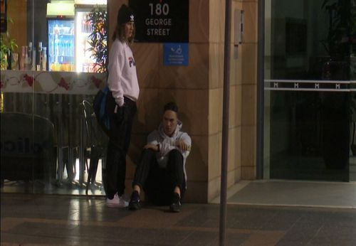 The teen's friends appeared visibly upset as they waited for him to be loaded into the ambulance. Image: 9News