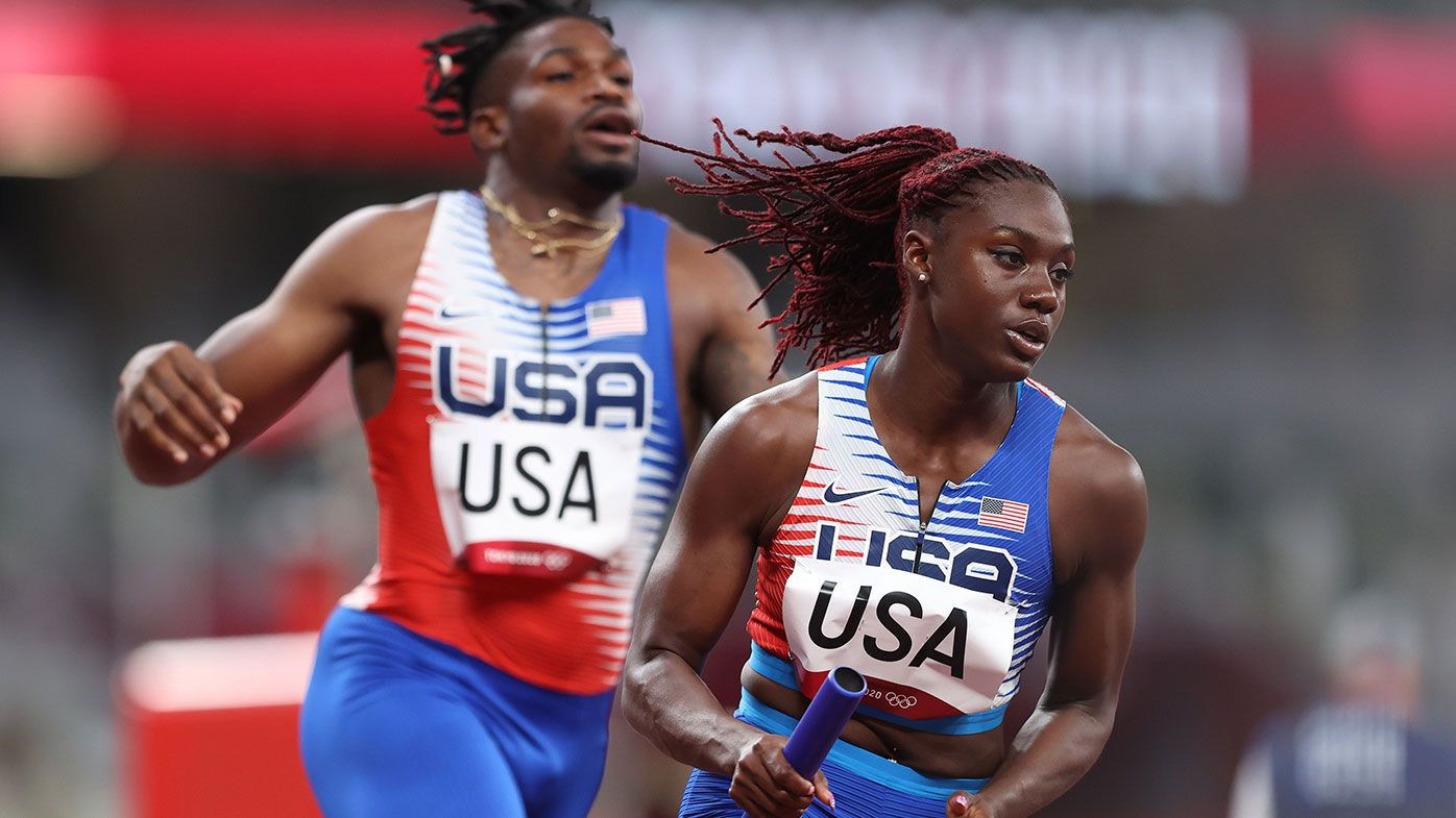 Lynna Irby of Team United States carries the baton while competing in the 4x400 Relay Mixed Round 1 on day seven of the Tokyo Olympic Games.