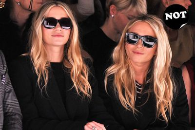 Can these two wear something <i>other</i> than boring black and 'I'm a star' sunnies to Fashion Week? C'mon, just once!