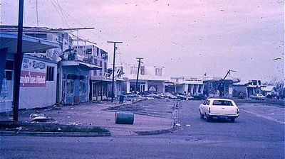 A lone car tours Fannie Bay shopping village in Darwin. (AAP)