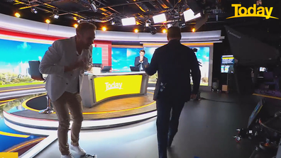 Tim hunched down in shock as a stoked Karl walked back to the news desk.