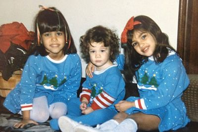 "Two years ago Kim Kardashian posted this throwback 1985 Christmas pic of herself with sisters Kourtney (left) and Khloe (middle) on her website. ""When we were kids it would be a day filled with excitement and anticipation before Christmas Day!"" she wrote."