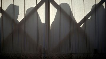 Nuns are silhouetted in St. Peter's Square at the Vatican. (AAP)