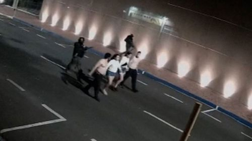 Hostages are marched away by heavily armed robbers.