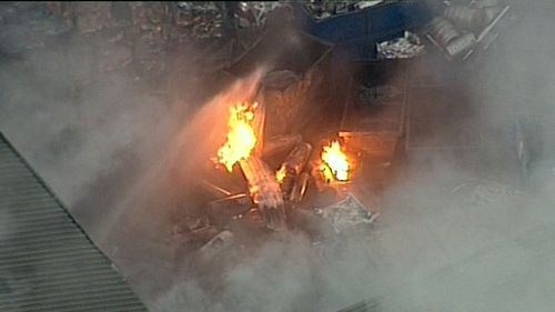 Sixty firefighters were called in to battle the blaze, which spread to a nearby building. Picture: 9NEWS