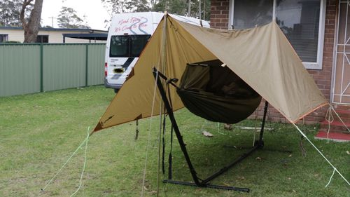 The tent Matt Walsh slept in for six months, including during winter, in his brother-in-laws Jervis Bay backyard.