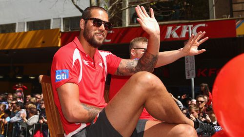Lance Franklin of the Swans waves to fans during the 2014 AFL Grand Final Parade in Melbourne. (Getty Images)