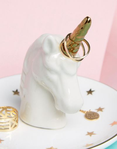 "<a href=""http://www.asos.com/au/sass-belle/sass-belle-unicorn-jewellery-holder/prd/7560380?iid=7560380&amp;clr=Multi&amp;SearchQuery=unicorn&amp;pgesize=36&amp;pge=0&amp;totalstyles=48&amp;gridsize=3&amp;gridrow=6&amp;gridcolumn=1"" target=""_blank"">Sass and Belle Unicorn Jewellery Holder, $17.</a>"