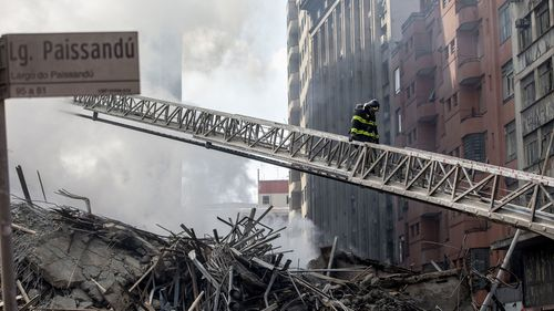 A high-rise building occupied by squatters in downtown Sao Paulo in Brazil has collapsed after catching fire, killing at least one person.