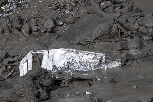 The wreckage of a car washed away by a mudslide resting in the bed of the Losentse River in Chamoson, canton Valais, Switzerland, 12 August 2019.
