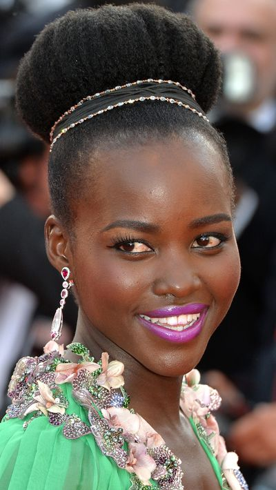 <p><b>Lupita Nyong'o</b> offset her soft green dress with a bright fuschia lip and jewelled hair adornment.</p>