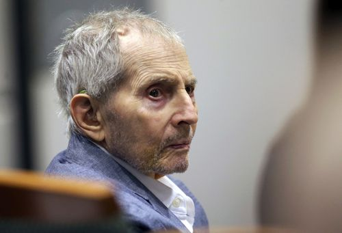 Real estate heir Robert Durst looks over during his murder trial in Los Angeles.