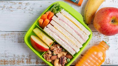 Ham and cheese sandwich in a school lunchbox stock image