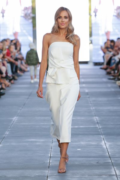"""<p>Rebecca Judd returned to the runway for British High Street staple <a href=""""http://www.next.com.au/en"""">Next</a>.</p> <p>The retailer made a determined pull at Australian's heartstrings bringing out Rebecca, Samantha Harris, Melbourne's top models and children striking Blue Steel poses at the Virgin Australia Melbourne Fashion Festival event.</p> <p>The outfits ranged from relaxed Sunday morning casual pieces to cool evening wear, with fresh shirting and slouchy denim pieces offering front row appeal.All of the pieces were available to shop immediately online. Expect Rebecca's opening red gown to be gone, stat.</p> <p>Next, Virgin Australia Melbourne Fashion Festival 2017.</p>"""