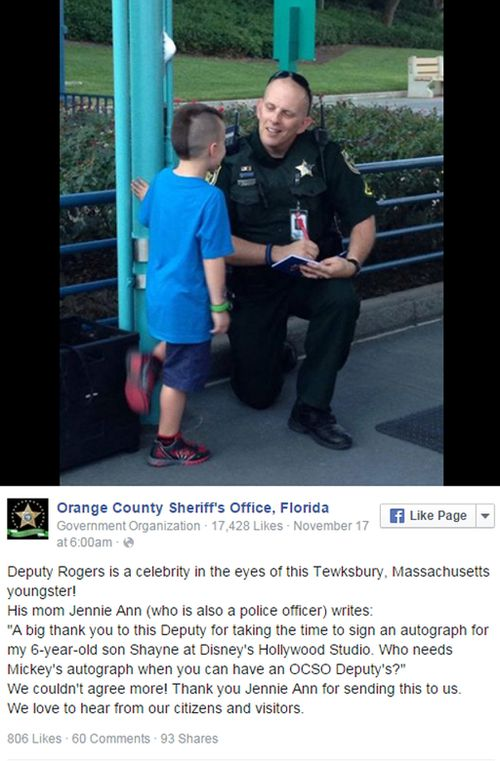 Boy seeks autograph at Disney World from police officer.  (Social Media)