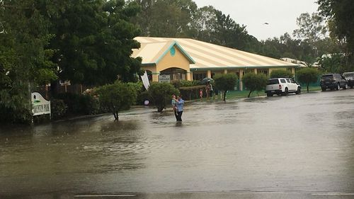 A child care centre is evacuated in Townsville. (Image: Tom Fowles/9NEWS)