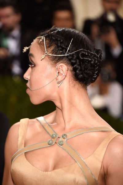 No one can pull off multiple facial piercings at a black tie ball like FKA twigs.