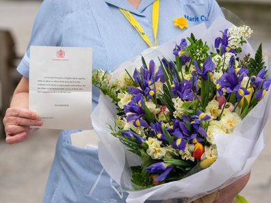 General view of flowers from Queen Elizabeth II to staff at St Bartholomew's Hospital, London, on the anniversary of the first national lockdown to prevent the spread of coronavirus. (Photo: March 23, 2021)