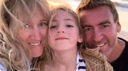 Kate Collins with her daughter Eva and husband Darren.